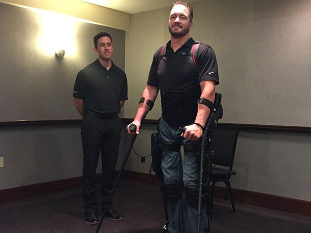 Paraplegic user stands and walks with the help of the Ekso GT, a robotic exoskeleton.