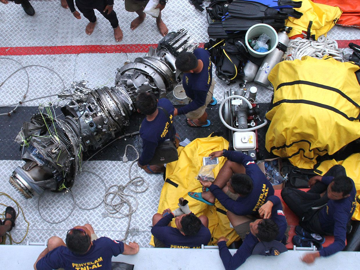 Parts of an engine of the ill-fated Lion Air flight JT 610 are recovered from the sea during search operations in the Java Sea, north of Karawang on November 3, 2018.