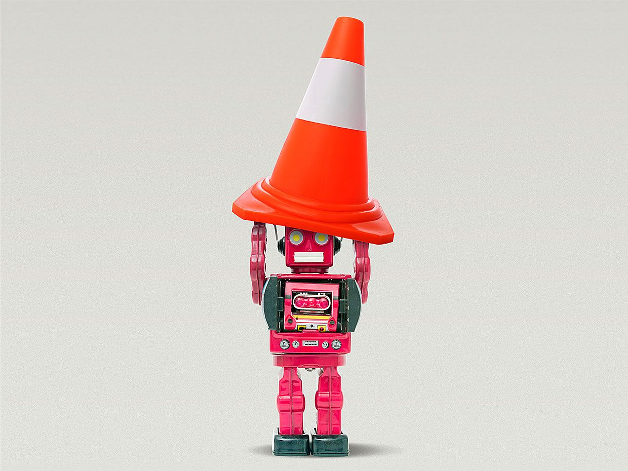 Photo-illustration showing a robot holding a traffic cone.