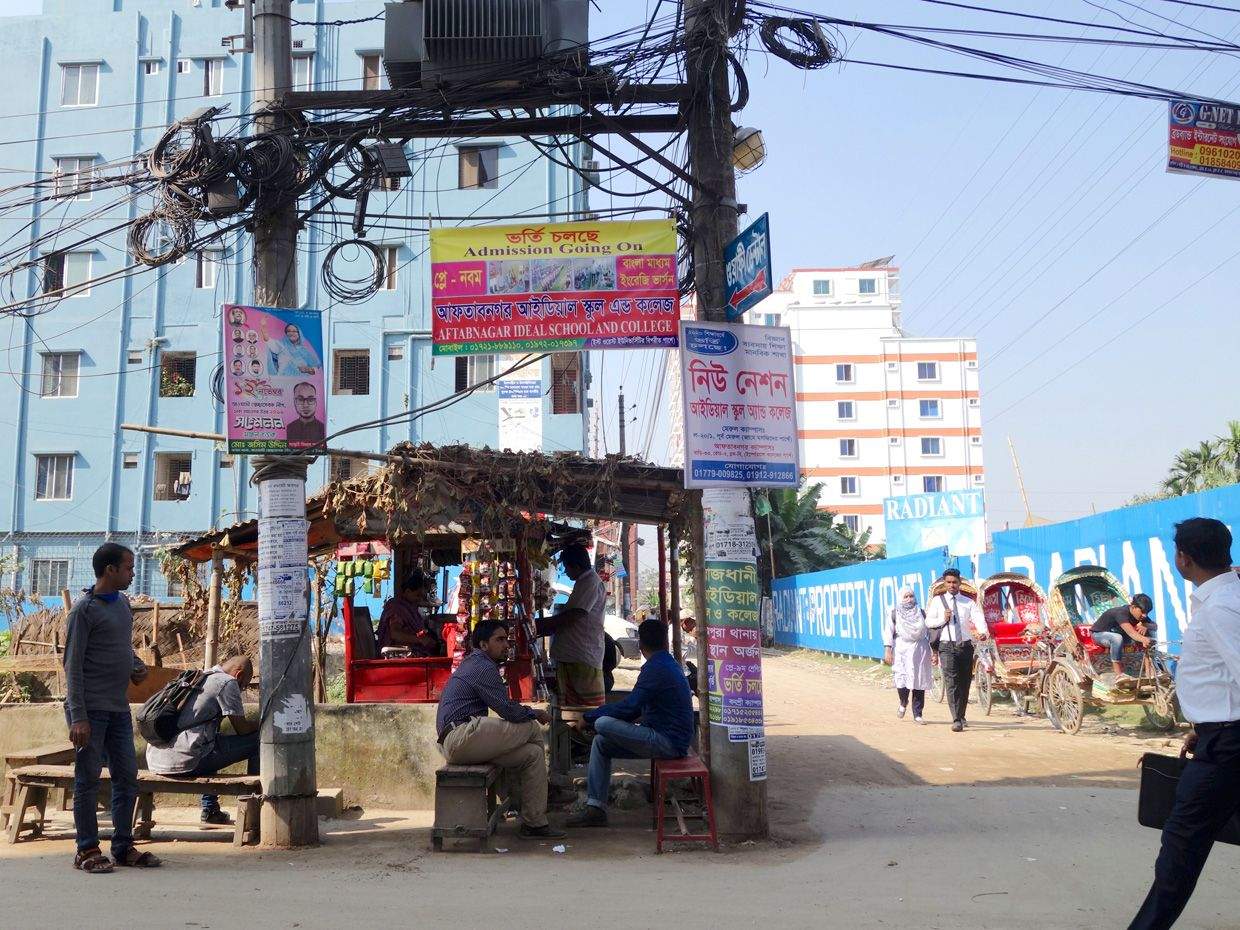 Photo of a tea house under a set up of power lines.