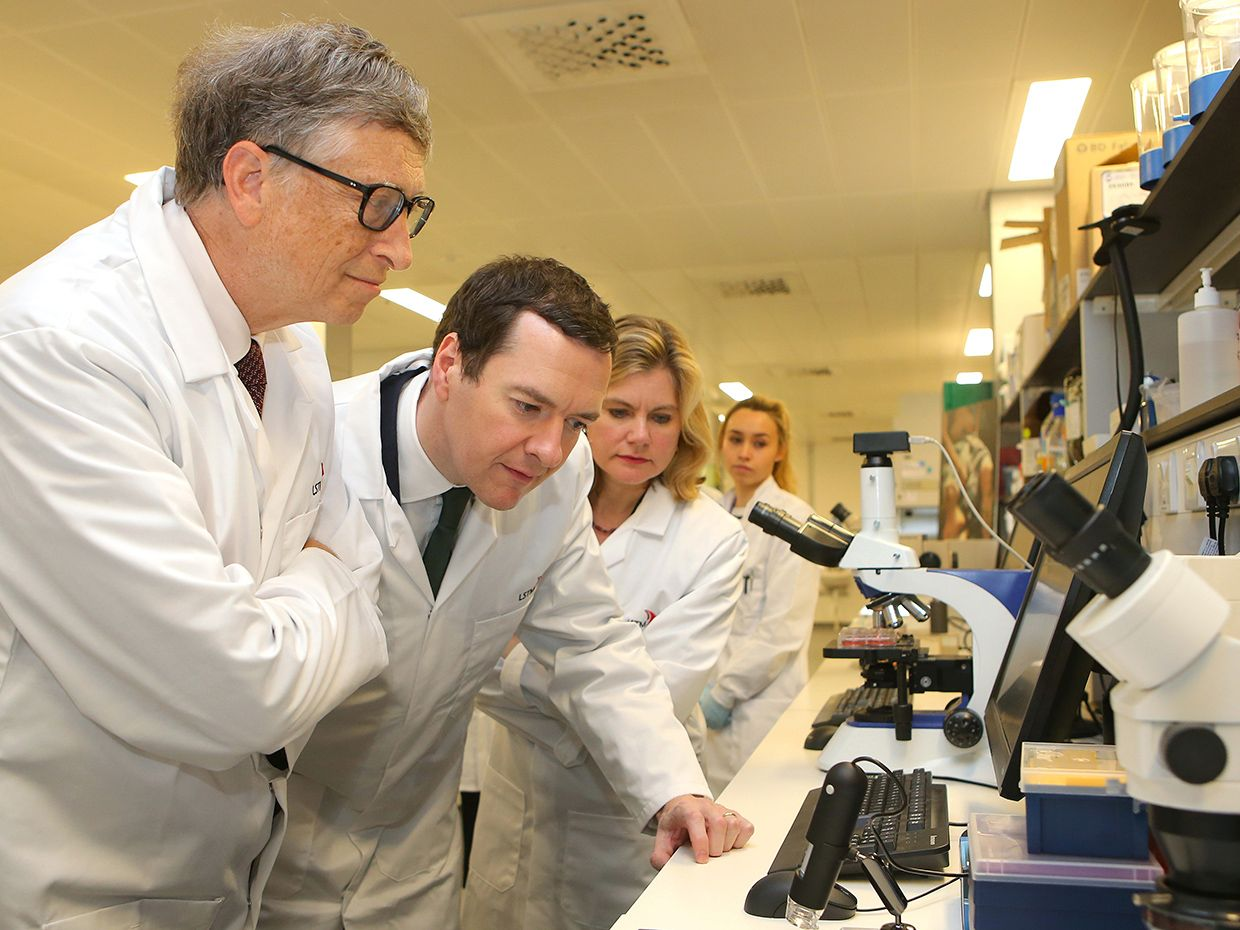 Photo of Bill Gates at the microscope