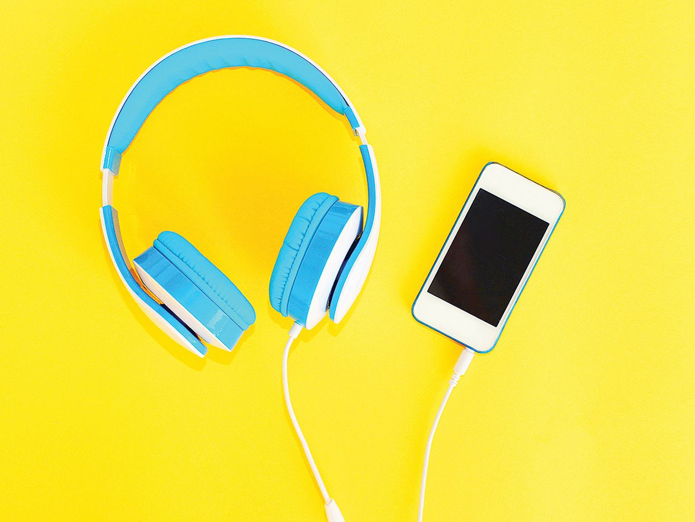 photo of headphones and smartphone