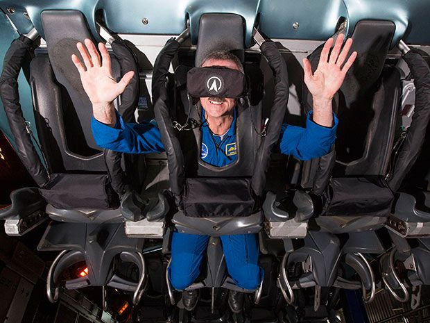 Photo of rider on a virtual reality roller coaster.