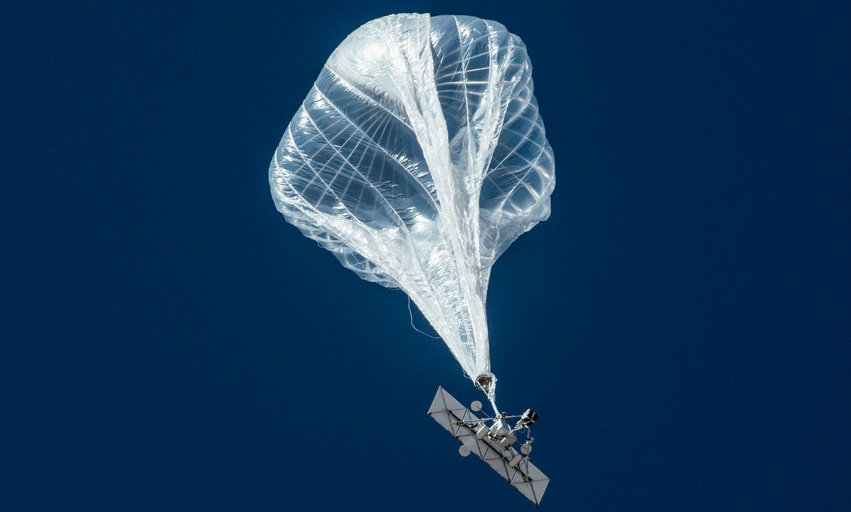 Photograph of a Loon balloon in the air.