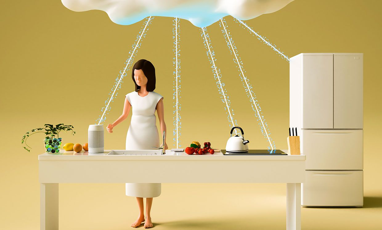 Photograph of miniature models of a Japanese woman in a kitchen with a cloud connecting to Internet of Things devices.