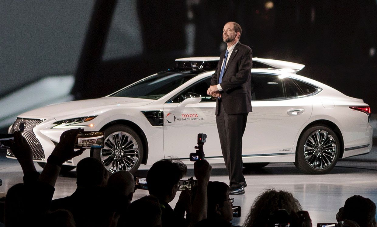 Photograph of Toyota Research Institute's Gill Pratt introducing Guardian technology at CES.