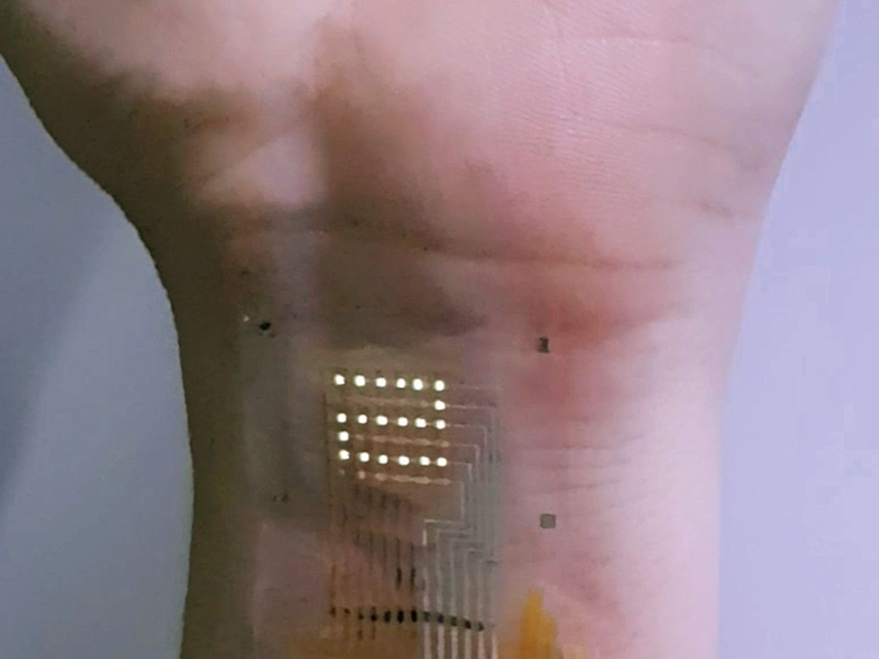 Photographic image of ultrathin AM-OLED display on the human wrist