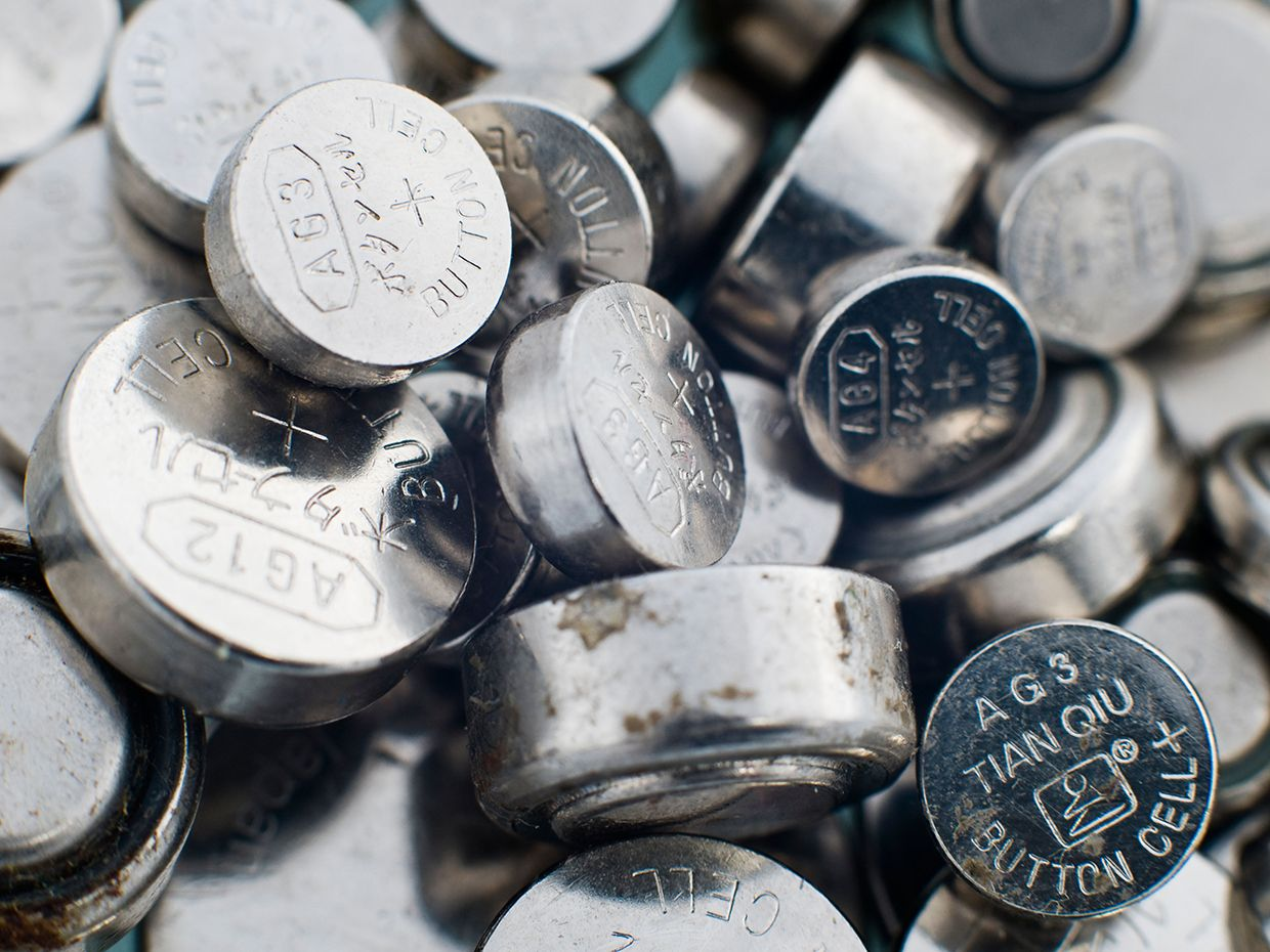 Pile of button cell batteries.