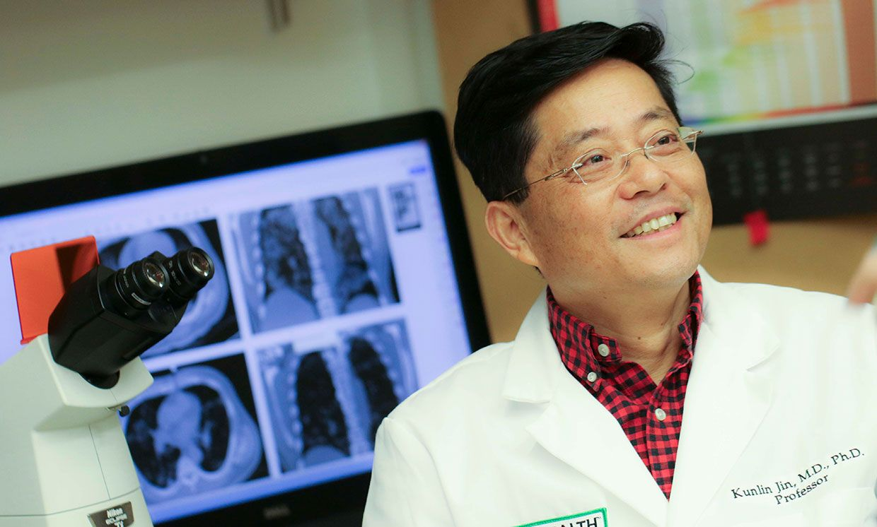 Researcher Kunlin Jin works with stem cells in his lab at the University of North Texas Health Science Center.