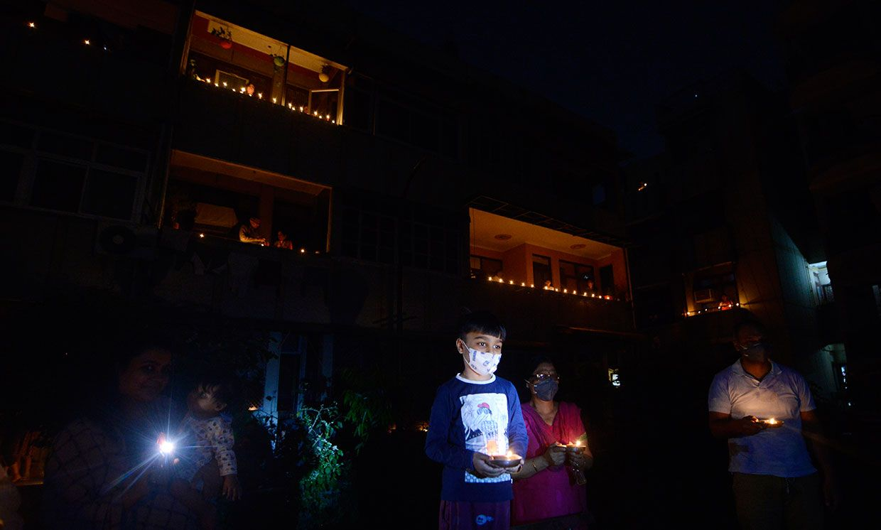 Residents light up candles and diyas to observe nine minutes of unity and solidarity as called by PM of India, to fight against dangerous Corona Virus in Country.