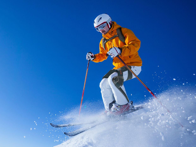Roam Robotics' skiing exoskeleton in action on the slopes.