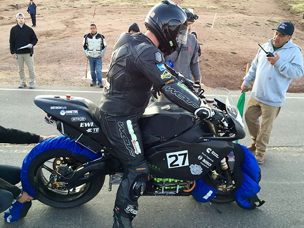 """Rob """"Bullet"""" Barber astride the Buckeye Current electric motorcycle"""