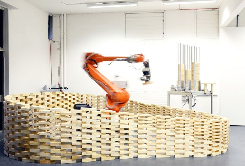 Robot arm builds wall
