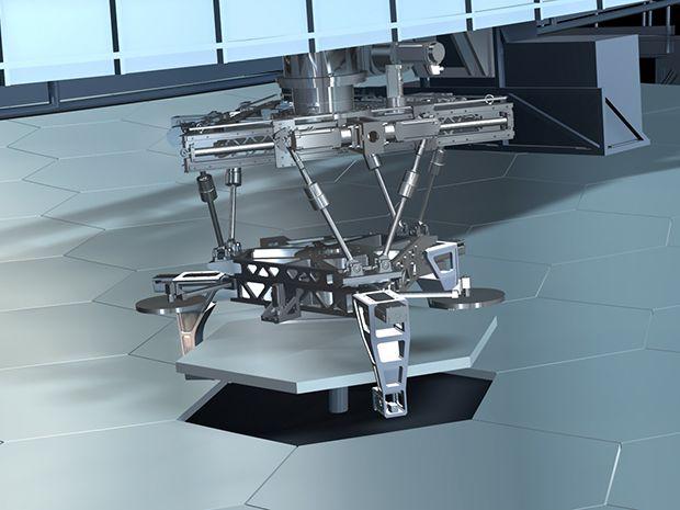 Robot grabbing a hexagonal mirror