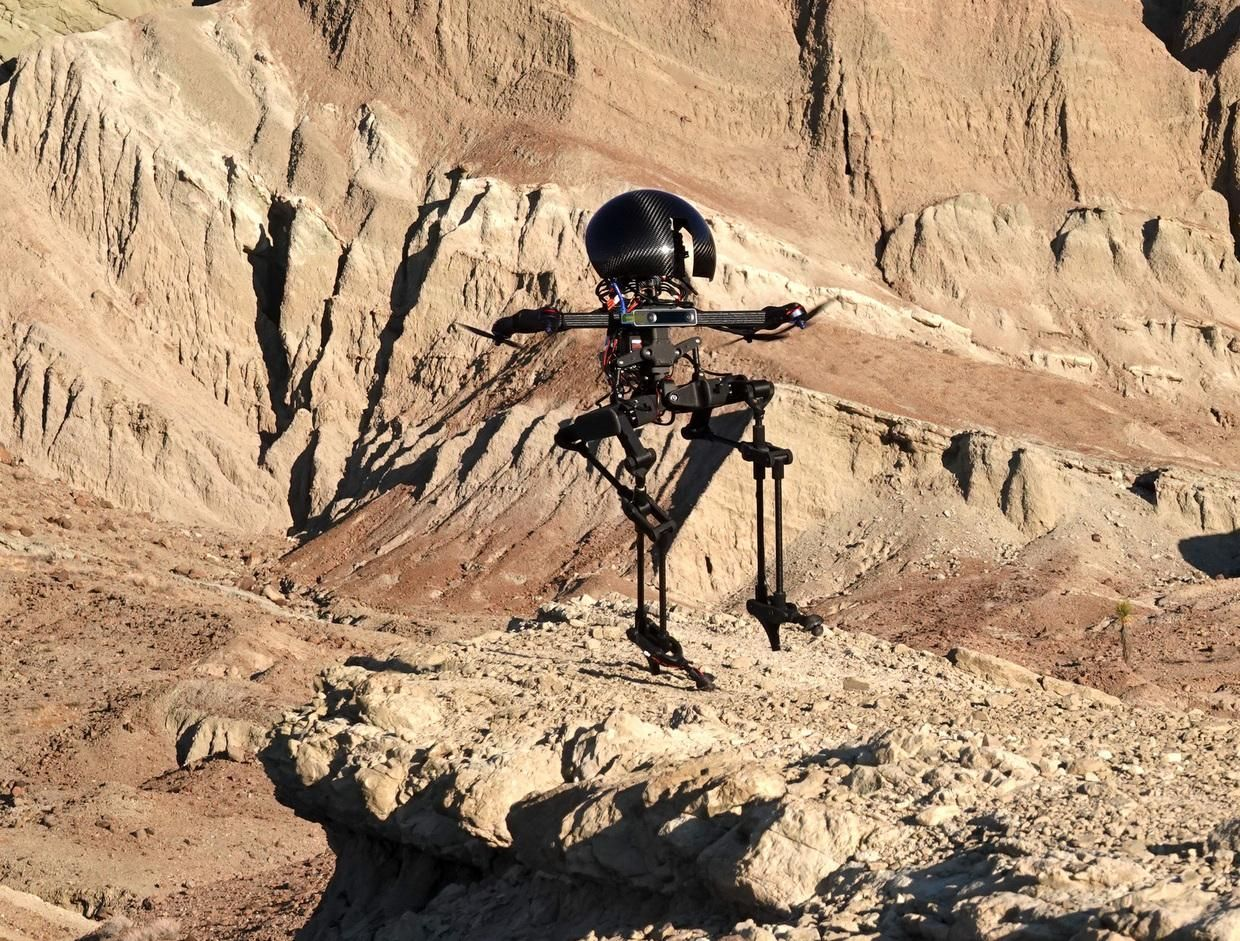 Robot with legs and propellers hovers above a rock formation