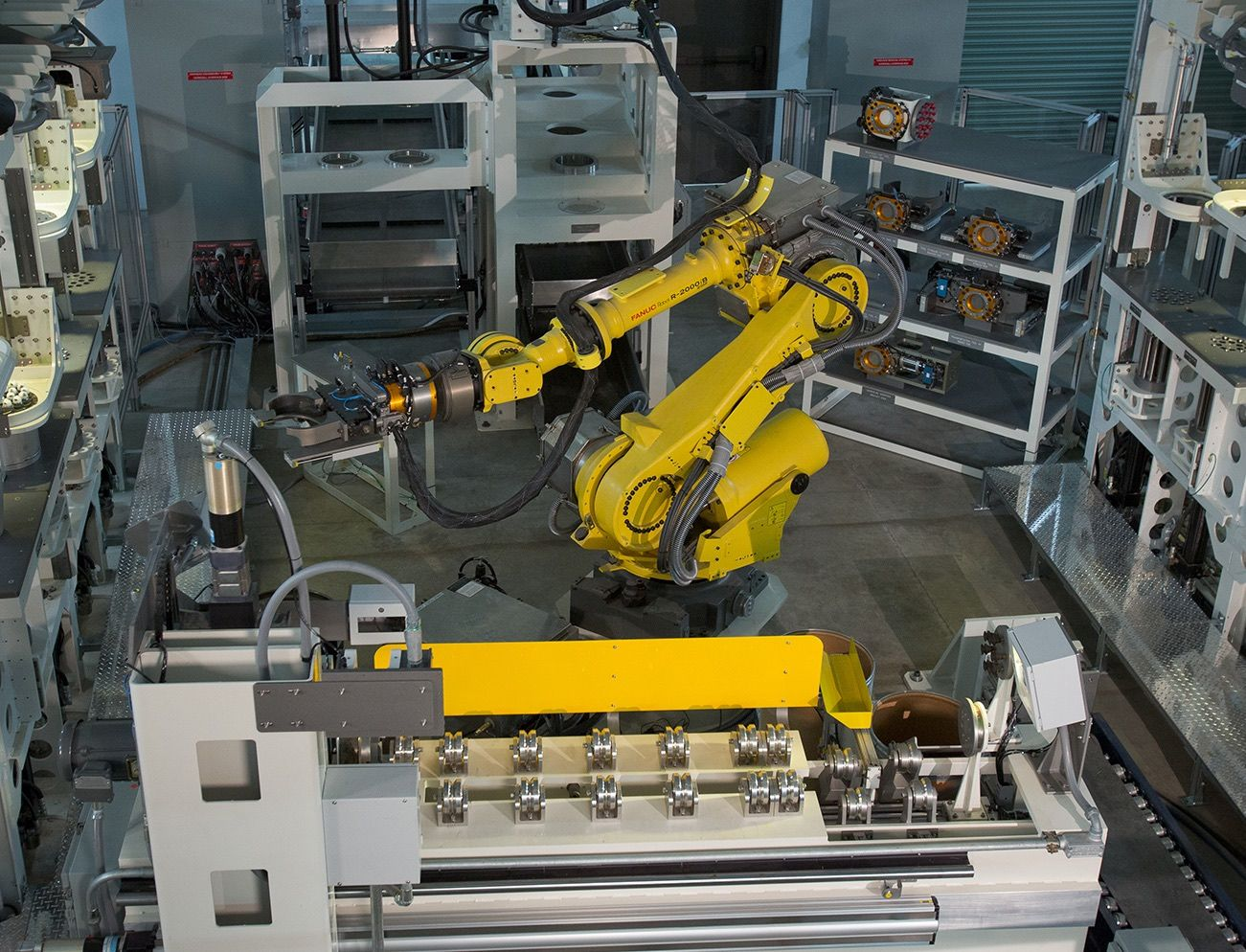 Sandia National Laboratories scientists built and programmed an automated robotic system to recycle weapons for the Army.