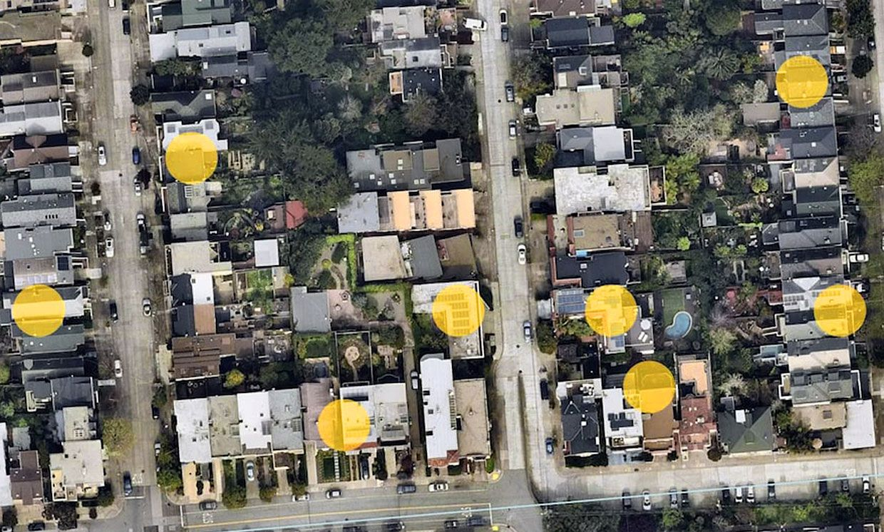 Satellite image with solar panels highlighted with yellow circles.