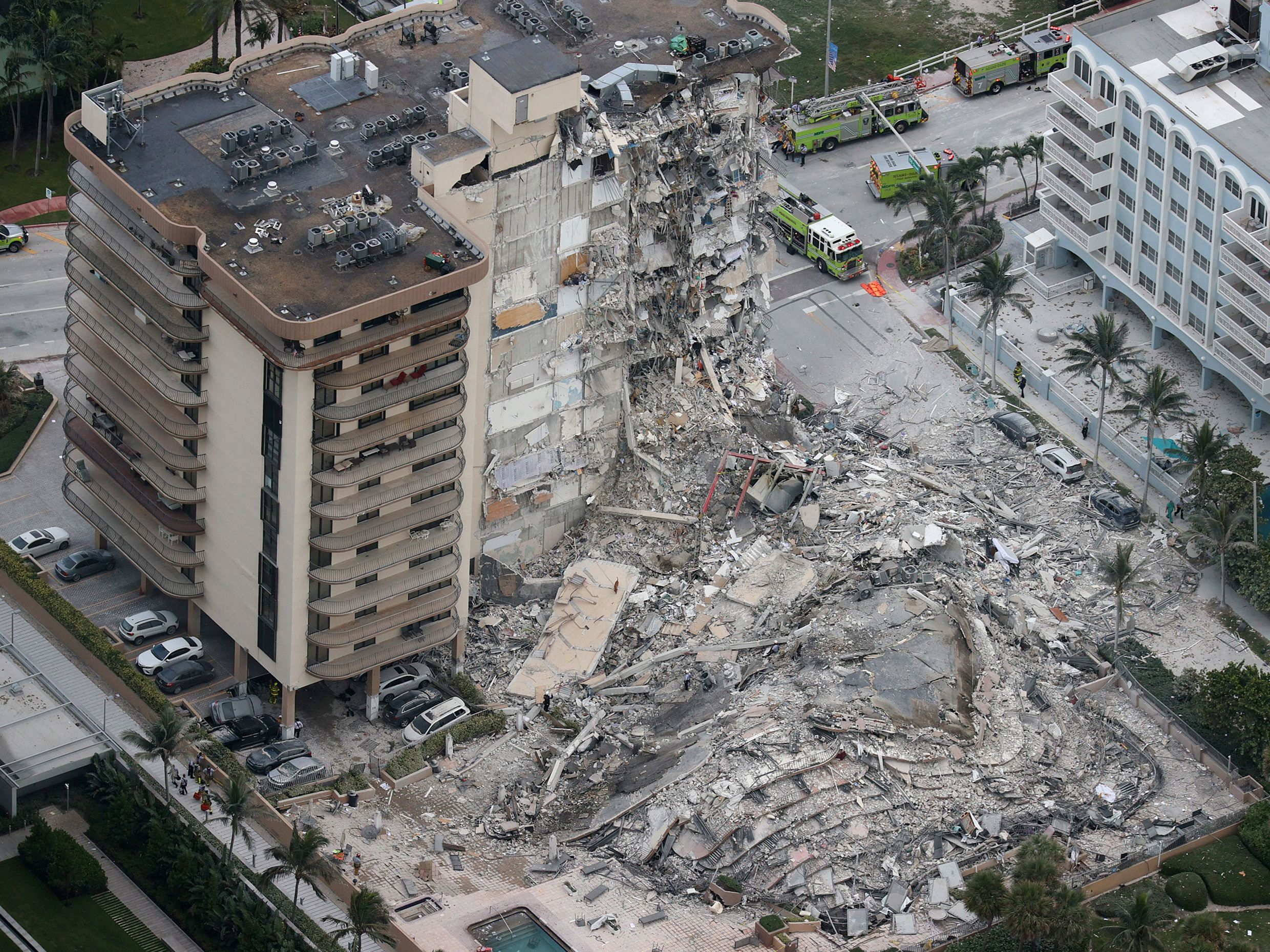 Search and rescue personnel work in the rubble of the 12-story condo tower that crumbled to the ground during a partially collapse of the building on June 24, 2021 in Surfside, Florida.