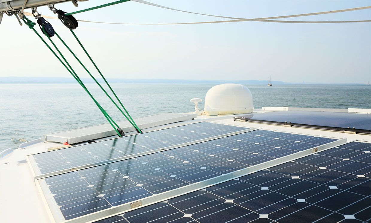 Stock photo of a boat with photovoltaic solar panels on it.
