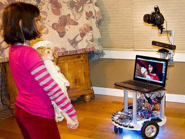 The author's 8-year-old interacting with Microsoft's Roborazzi, a mobile robot photographer.