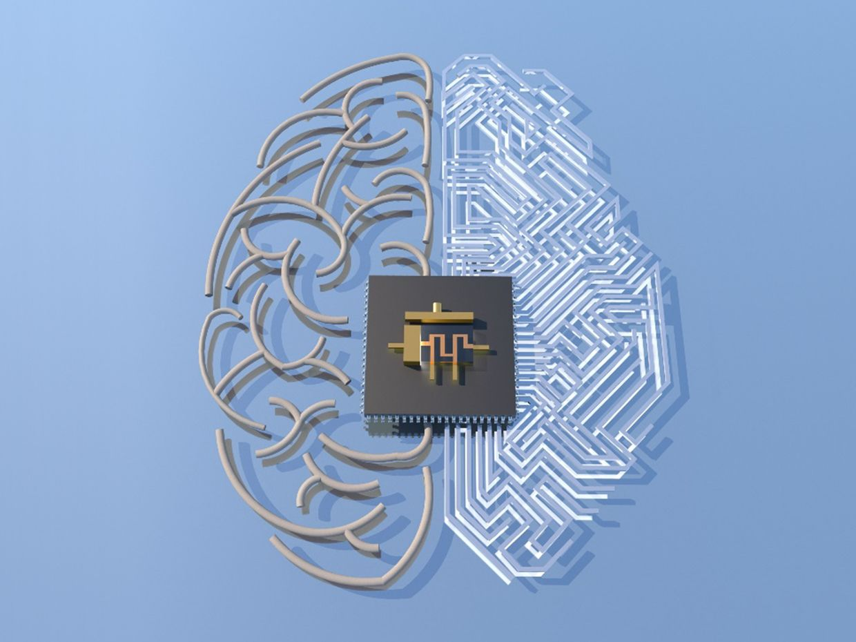 The memtransistor symbol is overlaid on an artistic rendering of a hypothetical circuit layout in the shape of a brain.
