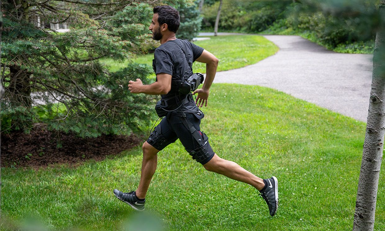 The portable exosuit is made of textile components worn at the waist and thighs, and a mobile actuation system attached to the lower back which uses an algorithm that robustly predicts transitions between walking and running gaits.