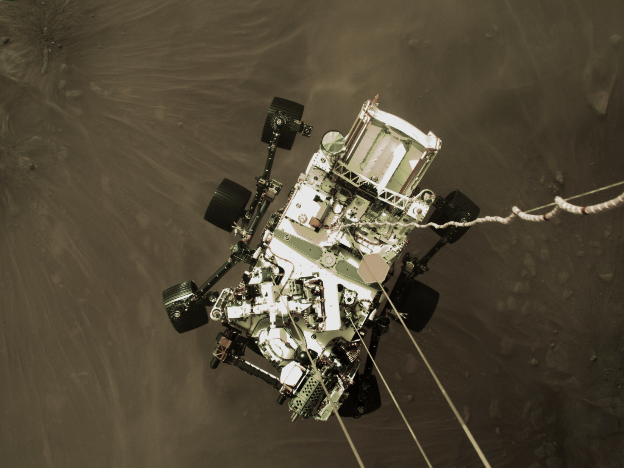 This high-resolution still image is part of a video taken by several cameras as NASA's Perseverance rover touched down on Mars on Feb. 18, 2021. A camera aboard the descent stage captured this shot.