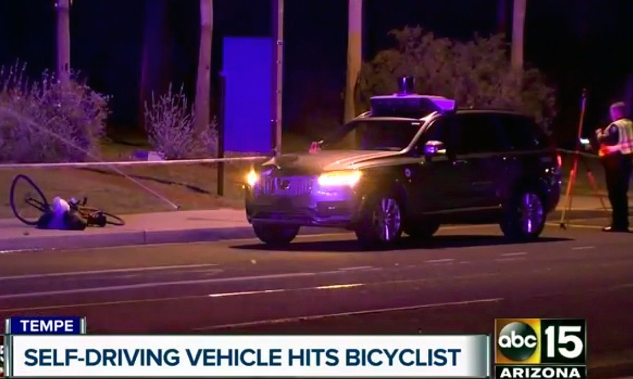 This March 19, 2018 still image taken from video provided by ABC-15, shows investigators at the scene of a fatal accident involving a self driving Uber car on the street in Tempe, Ariz.