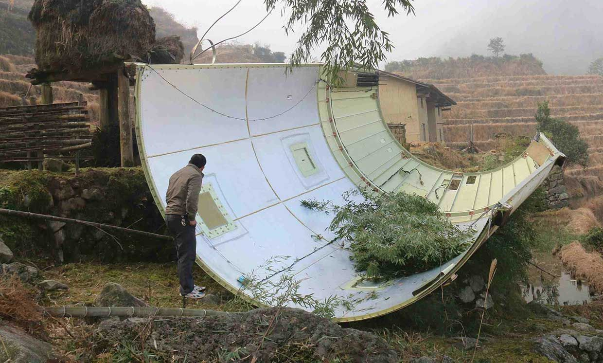 This picture taken on December 11, 2016 shows a piece of a Long March 3B rocket after it fell in a field in Suichuan County in China's central Jiangxi Province.