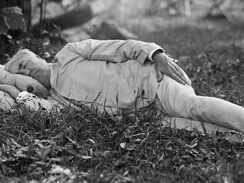 Thomas Edison taking a nap outdoors