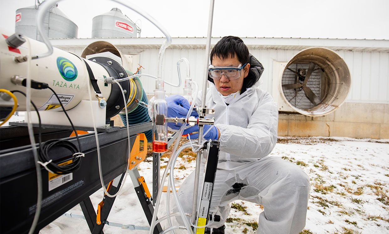 Tian Xia puts the final touches on a lab-scale non-thermal plasma device that can achieve 99% inactivation of an airborne viral surrogate, MS2 phage, a virus that infects E.coli bacteria at the Barton Farms family pig farm.