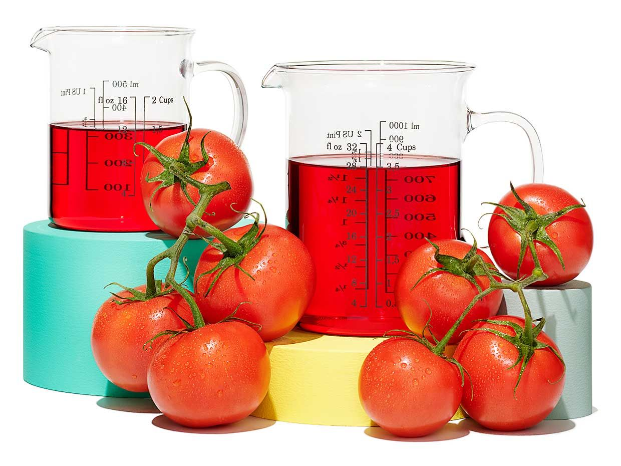 Tomatoes and beakers of red liquid.