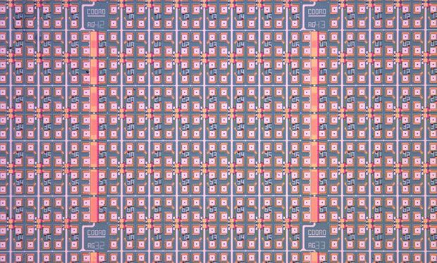 Top view of an array of molecular monolayer devices fabricated on a four inch silicon wafer with individual contact pads for electrical characterization of single pores