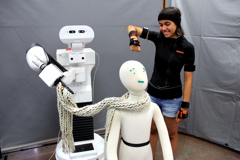 Transferring human motion to a mobile robotic manipulator.