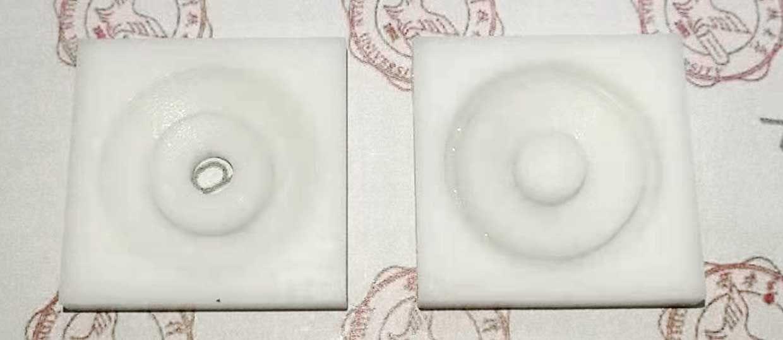 Two 3D-printed ultrasonic hologram lenses (lens for hole hologram, left; lens for conventional hologram, right).