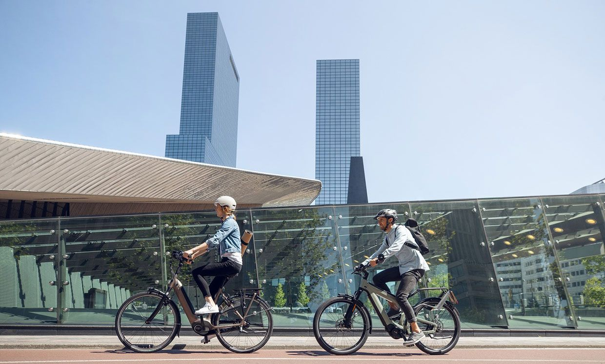 Two persons riding their electric bike