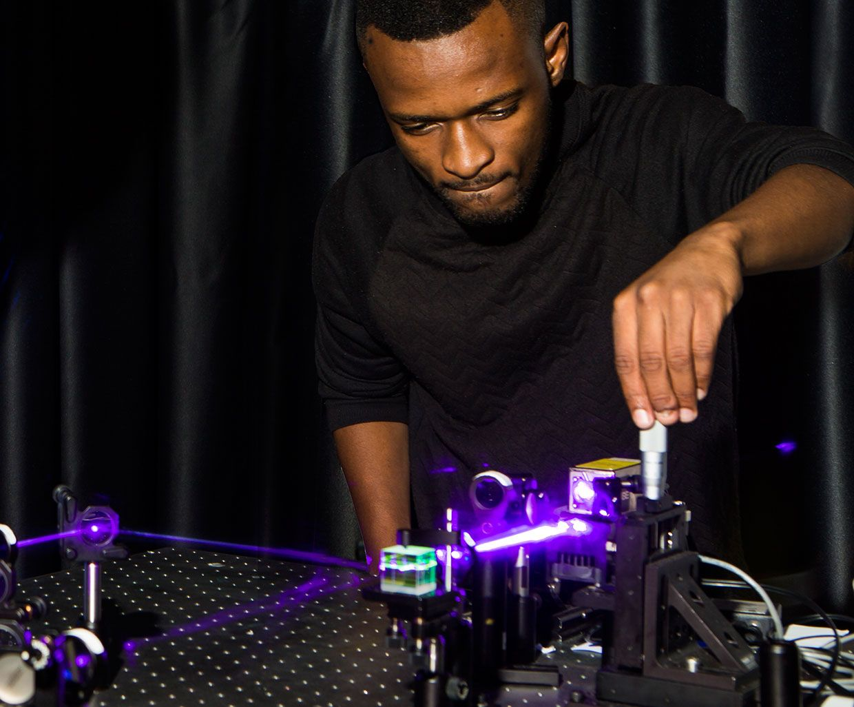 Wits Ph.D. student Isaac Nape -- one of the two lead Ph.D. students on the project -- aligns a quantum entanglement experiment.