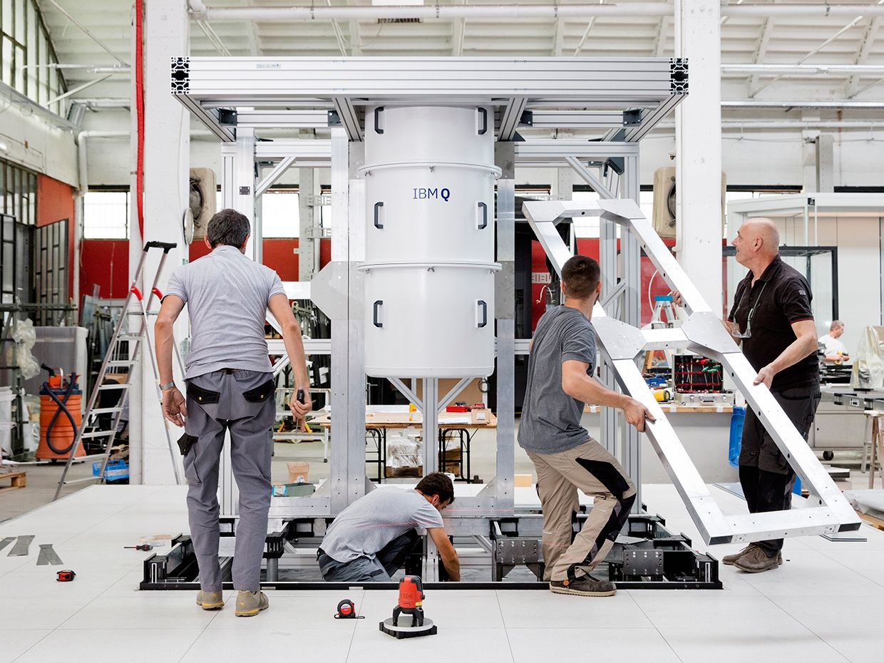 Workers assemble the enclosure for the IBM Q System One quantum computer.